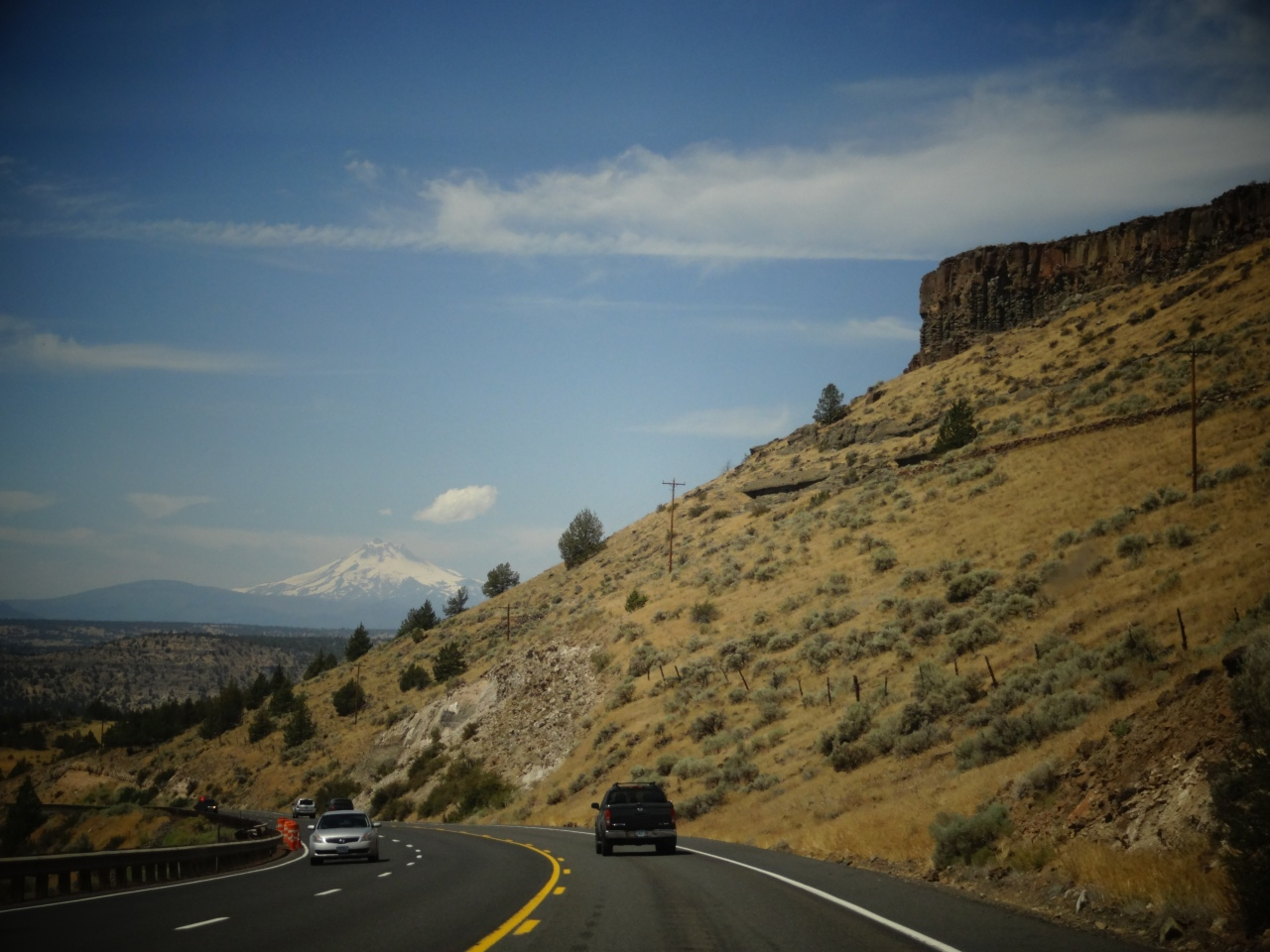 Driving Route 97 in Oregon. That White Peak is Mount Hood at: 11,249 ft (3,429 m)