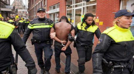 Demonstrator gets arrested.